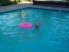kid in pool swimming enjoys the water