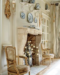 Cathy Kincaid Interiors | Cathy Kincaid Interiors - plates & jars used over fireplace