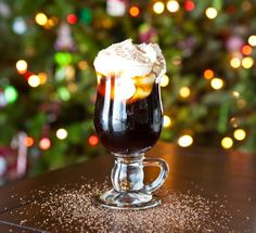 Christmas Coffee Cocktail  INGREDIENTS:  4 oz strong coffee  1 1/2 oz amaretto liqueur  1 1/2 oz coffee liqueur  1 oz butterscotch schnapps  1 oz creme de cocoa  fresh whipped cream  grated chocolate, for garnish