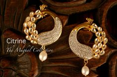 Creatively Carved Life: Exclusive jewellery of CITRINE by purvi druv-II Jewelry Design Earrings, Gold Earrings Designs, Gold Jewellery Design, India Jewelry, Temple Jewellery, Ideas Joyería, Indian Earrings, Peacock Earrings, Peacock Jewelry