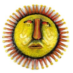 Beautifully handcrafted using recycled steel oil drums, this 10-inch three dimensional Sun Face Wall Art comes to us from Fair Trade artisans in Haiti. The sun face has a convex shape, features a protruding nose and comes with a hook on back for hanging.  It is sponged painted in two different color combinations and suitable for displaying indoors or outdoors.