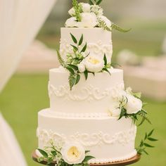 A beautiful and classic wedding cake with white peonies