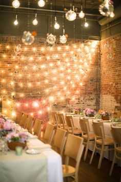 Glam string lighting to light up the room! Photo: First Comes Love via Elizabeth Anne Weddings