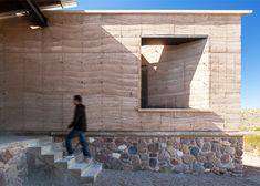 The Cave is a rammed-earth and stone villa in Mexico by Monterrey Studio Greenfield