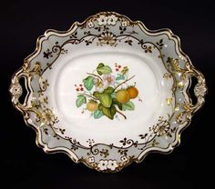 A Ridgway Porcelain Botanical Dessert Service decorated with Fruit,  Circa 1830   The dessert service is decorated with lovely grey ground panels overlaid with goldflowers and scroll work with a central painted botanical design of fruits and flowers, each piece depicting a different fruit, with relief-moulded edge and border shape with moulded flowers near the rim. The service consists 18 pieces: