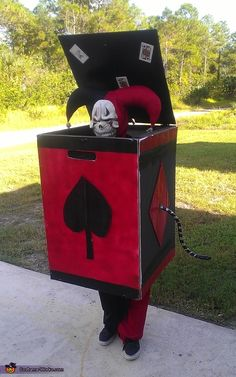 Barry: my son dustyn is wearing the costume it is made with a wooden frame straps to hold it up cardboard for the sides it has a crank and a flip...