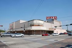 """In 2009, after Hurricane Ike blew away part of Sears' corrugated-metal """"slipcover,"""" you could make out the elegant Art Deco sign and building underneath. Photo: Jim Parsons"""