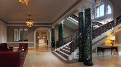 Waldorf Astoria Edinburgh's grand stairway is framed by beautiful marbled pillars.