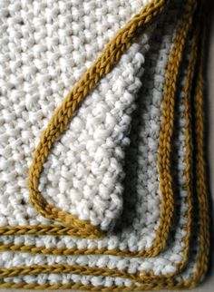 Eleventh Hour Blanket  This super bulky afghan is soon to become your favorite pattern. Knit with two strands of bulky yarn at once, the Eleventh Hour Blanket is the cuddliest and quickest blanket you'll ever make! Not only does it have great texture, courtesy of the seed stitch, but it also features an attractive i-cord edge!