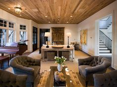 Love the ceiling...piano area...and two separate, functional spaces.