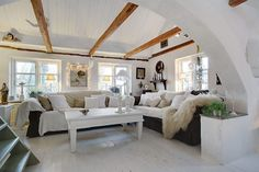 Swedish home. Love the ceiling, mix of wood and concrete wall!