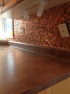 Pinterest project 4 penny backsplash for stove for the for Copper penny tile backsplash