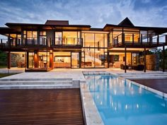 Double-volume glass facades and a unique spiral staircase create a sense of timeless quality and appeal in this Zimbali Coastal Resort property. Modern Pools, Kwazulu Natal, Glass Facades, 4 Bedroom House, World Cities, Beautiful Places In The World, Laguna Beach, Beach House, Places To Go