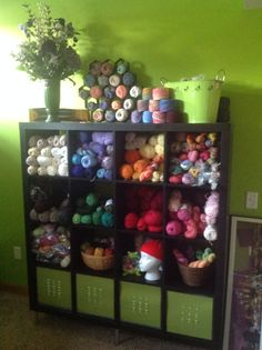 Craft room yarn and knitting storage in an Ikea Expedit.