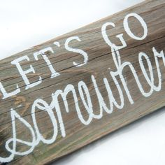 Lets Go Somewhere Pallet sign Adventure awaits Cool gift Gift for teen Unique gift idea Handmade gift Travel gift Gift for student Wood sign  • Handcrafted and painted by North Carolina artisans • Created with naturally distressed, reclaimed wood • Share your love of adventure with this rustic sign! • Dimensions: 13 x 5.5 *This item is made to order. Some variations in color will occur depending on the wood available  Display your love for adventure with this Lets Go Somewhere reclaimed…