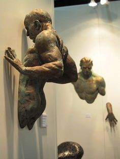 This resonates with me because I am interested in creating a piece that comes out of the wall. Creating some kind of conflict. wall sculpture - men - partial figures emerging from the wall Arte Do Hip Hop, Bronze Sculpture, Figurative Art, Installation Art, Ceramic Art, Amazing Art, Awesome, Fantasy Art, Sculpting