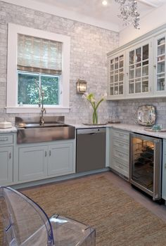 Love this kitchen - stainless farmhouse sink, sage lower/white upper cabinets, counter-to-ceiling backsplash, everything right down to the Louis XIV ghost chair