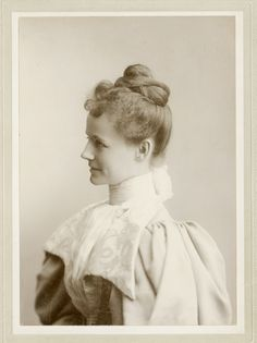 elegant woman in profile, high neck line and mutton sleeves.  c. 1895