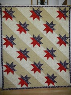 Beautiful Patriotic Quilt, made by Sue in Arizona, for QOV.  She used the Split star pattern.  source:  Marjorie's Quilting Bee.  So beautiful!  I love it!