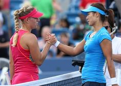MASON, OH - AUGUST 19:  Angelique Kerber of Germany shakes hands with Li Na of China during the final on day nine of the Western & Southern Open at Lindner Family Tennis Center on August 19, 2012 in Mason, Ohio.  (Photo by Nick Laham/Getty Images)
