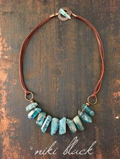 Made this necklace using leather, brass finding and nuggets of a natural stone.