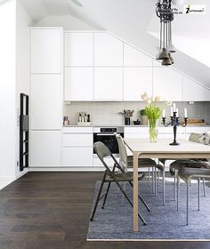 white modern kitchen with sloped ceiling