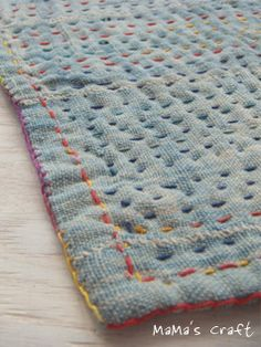 make a little throw out of patchwork recycled wool and quilt like this!