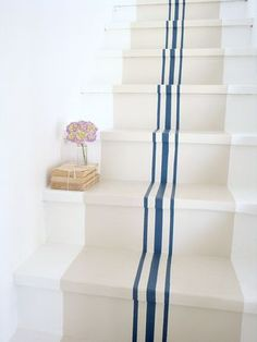 Striped-stairs, like a vintage grain sack...how cool is this?  Maybe up the stairs to my attic.