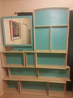 Dumpster dived dresser drawers and medicine cabinet repurposed to make a nice little bookshelf. The drawers and cabinet are anchored to a plywood backing for added stability. All the materials are...