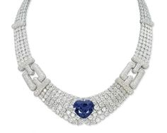 A SAPPHIRE AND DIAMOND NECKLACE, BY CARTIER   Designed as four rows of graduated brilliant-cut diamonds to the central heart-shaped sapphire and pavé-set diamond clasps, 41.0 cm long, with French assay mark for gold, in red leather Cartier case  Signed Cartier, no. 610023