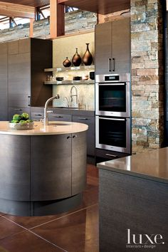 ♂ A crescent-shaped island topped with Cesarstone acts as a central and convenient food prep area in this contemporary kitchen. Photograph by David O. Marlow from http://www.luxesource.com/photo/kitchens/8312
