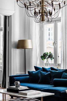 Blue velvet sofa and bold bedrooms: modern apartment in Stockholm #design #home #decor #idea #inspiration #cozy #style #blue #sofa #velvet #livingroom