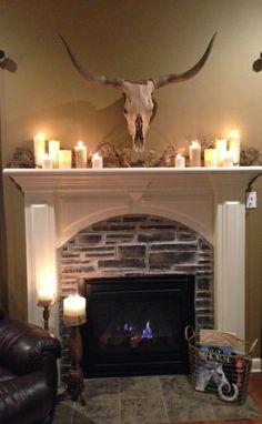 Fireplace, candles, Longhorn skull, western Mantel