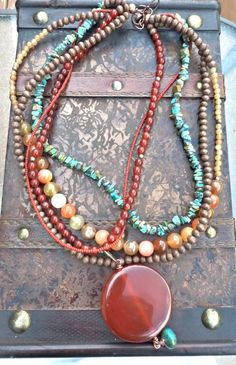 Differing sized beads Orange agate pendant, orange and peach agate stone, Green turquoise stone chips, wood and copper necklace. Stone Jewelry, Beaded Jewelry, Jewelry Necklaces, Handmade Jewelry, Copper Necklace, Boho Necklace, Necklace Ideas, Fashion Necklace, Necklace Set