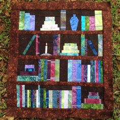 Looking for your next project? You're going to love Bookshelf Quilt - PAPER PIECING PATTERN by designer VeryLazyDaisy.