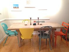 Created our own mix & match dining chairs and farm style table to create a bright eclectic dining area.