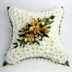 White sprays chrysanthemums forming the base for an elegant spray of superior flowers such as orchids and roses. Funeral Floral Arrangements, Spring Flower Arrangements, Spring Flowers, Casket Flowers, Funeral Flowers, Funeral Caskets, Funeral Ideas, Heart Cushion, Funeral Tributes