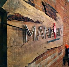 Metal office style signage on raw live edge reclaimed wood panel. Hair salon reception area sign for Mankind grooming - Office sign # donor wall Office Signage, Wayfinding Signage, Signage Design, Wall Logo, Logo Sign, Reclaimed Wood Paneling, Wooden Logo, Church Interior Design, Metal Signage