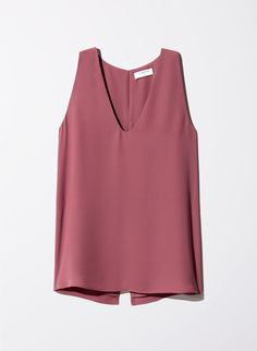 The Maddox is a sleeveless blouse with an elongated hem for an extra bit of length and coverage. It's made from an elevated, silky fabric. Long Blouse, Sleeveless Blouse, Look Fashion, Fashion Outfits, Western Tops, How To Look Classy, Purple Blouse, Dress Me Up, Office Dresses