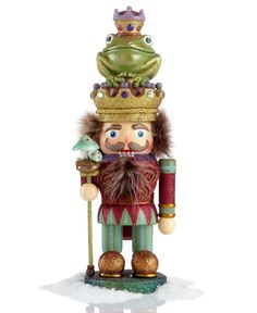 Tell a story with your holiday decor, starting with the Frog Prince. Toadstools on his staff and a creature in his crown make this whimsical nutcracker the embodiment of Grimm's beloved fairy tale. |