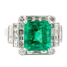 5.28 Carat Colombian Emerald Diamond Platinum Ring | From a unique collection of vintage fashion rings at http://www.1stdibs.com/jewelry/rings/fashion-rings/
