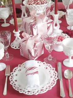red, pink + white christmas table.  I enjoy a wrapped little gift at each place setting :-)