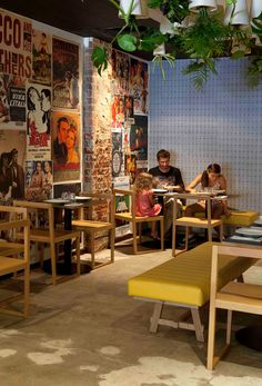 Nice interior of Dough pizzeria in Perth, Australia. I love the upside down plants on the ceiling and the vintage posters on the wall. Love the yellow furnitures as well.