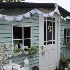 Adorable garden shed or workshop. wickes garden colour bluebell with a touch of herb paint for a smokey blue , such pretty bunting too . Painted Garden Sheds, Painted Shed, Outside Paint, Wendy House, Shed Colours, She Sheds, Garden Office, Colorful Garden, Summer Garden