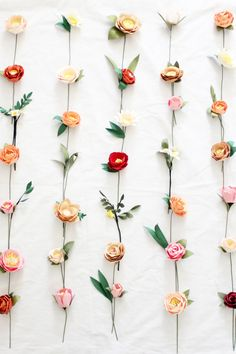 20 assorted paper flowers for your wall or backdrop. We only provide the  paper flowers embellished with leaves and a stem and we recommend you  taping them to your wall with washi tape to create the wall. We can  customize the color to match your theme for your event, whether it's for a  baby shower, bridal shower, wedding, or just a ladies night out, these  paper flowers will be the perfect decoration!  For more pictures go to our:Paper Flowers Album  100% Handmade  For more quantities…