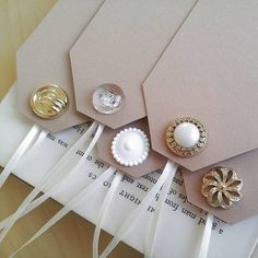 parcel tags- decorated with a single button- can be used as name cards attached to a favour or a glass. great vintage feel.