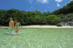 Seychelles Honeymoon  Romance; Stunning turquoise ocean and soft sand beach at the tropical island resort of Sainte Anne, Seychelles.