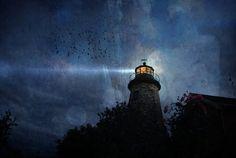 Spotlight - lighthouse shining in the night