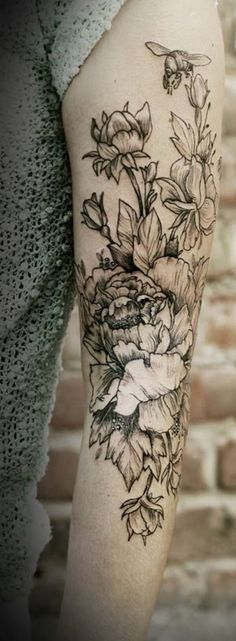 Flower tattoo with a bee