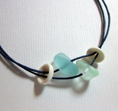 Puka shells & Sea Glass! I want to make one of these for my self. dressy and casual! :)